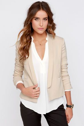 """Take your chic office style to the next level in the Insider Trading Beige Blazer! This woven poly blazer has stylish lapels that lead from the collar down the open front to just above the bottom hem. Princess seams traverse the bodice as well, and end at the front slit pockets. Long buttoned sleeves, and a bright orange polka dotted lining finish off this cute piece of office wear. Fully lined. Model is wearing a size small. Blazer measures 3"""" longer at front. Self: 95% Polyester, 5% ..."""
