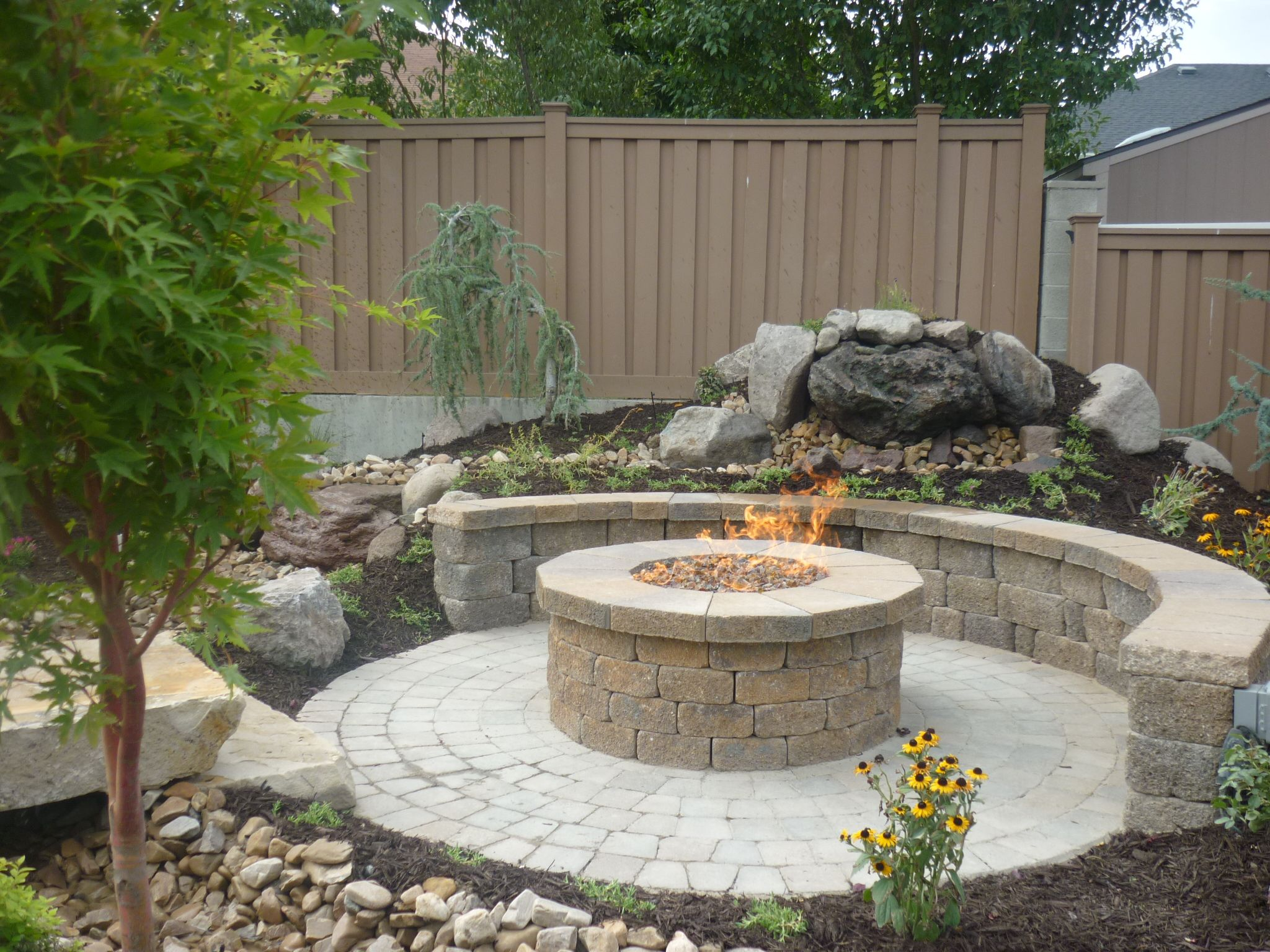 Raised fire pit landscaping pinterest exterior design backyard patio ideas patio ideas great circular paver patio kit with large round outdoor fire pit and do it yourself retaining wall from natural sandstone solutioingenieria Images
