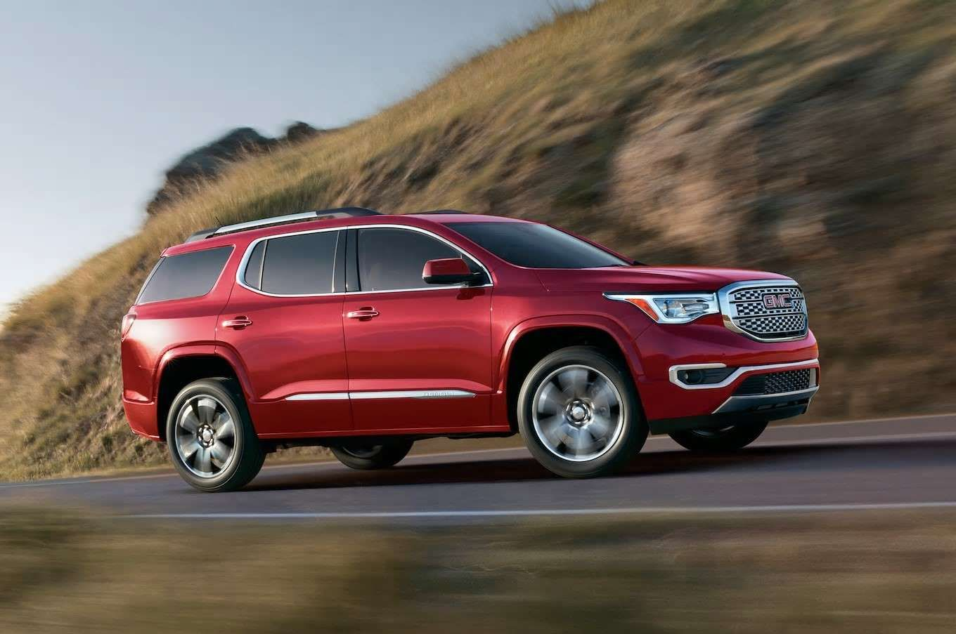 A Car Parked On The Side Of A Road Acadia Denali Gmc Acadia
