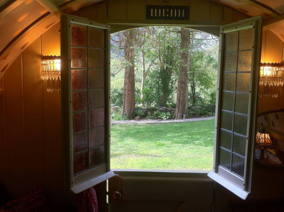 Airbnb Gypsy Wagon in Lauragh, Ireland. $68 USD per night.   This glamping site offers accommodation and breakfast in gypsy wagon and a vintage caravan ( see Chez Shea vintage glamping- also listed with  Airbnb) Both have been carefully restored,  featuring very different interiors. - Get $25 credit with Airbnb if you sign up with this link http://www.airbnb.com/c/groberts22