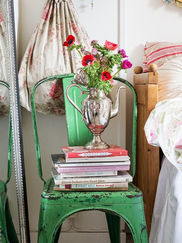 That vintage green chair looks so lovely among the rustic red elements.