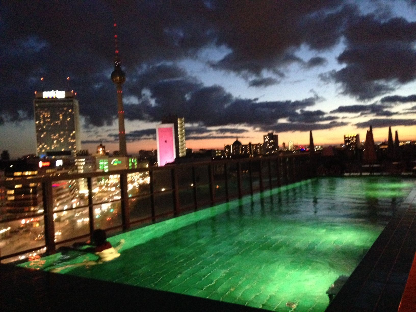 Soho house berlin rooftop heated pool at night