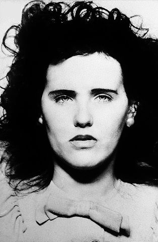 "Elizabeth Short (aka The Black Dahlia)  Detail from her mugshot - she was arrested in Santa Barbara on September 23rd 1943, age 19, for underage drinking.   The Santa Barbara police recorded her statistics as, ""5' 7""; weight 130 lbs.; complexion fair; hair black; eyes, hazel green; mole on face."""