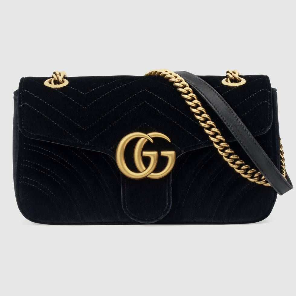 50a89e7ecb50 Shop the GG Marmont velvet shoulder bag by Gucci. The small GG Marmont  chain shoulder bag has a softly structured shape and an oversized flap  closure with ...