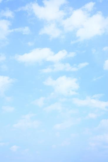 Light Blue Spring Sky with Clouds, May Be Used as