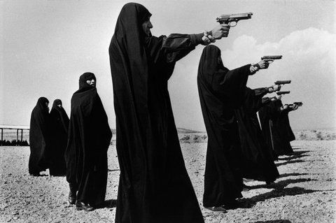 TEHRAN, Iran — Veiled women training in shooting on the outskirts of the city, 1986. PHOTO: Jean Gaumy Magnum Photography