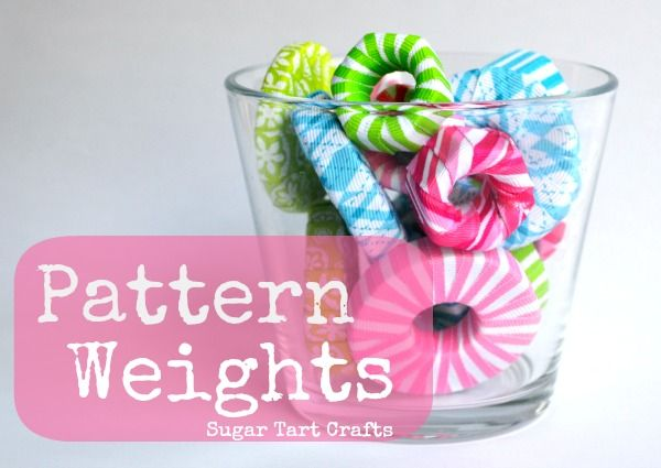 A bowl of colorful pattern weights made from washers and nuts