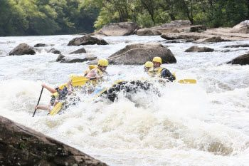 White water rafting includes dips, drops, splashes, and waves.