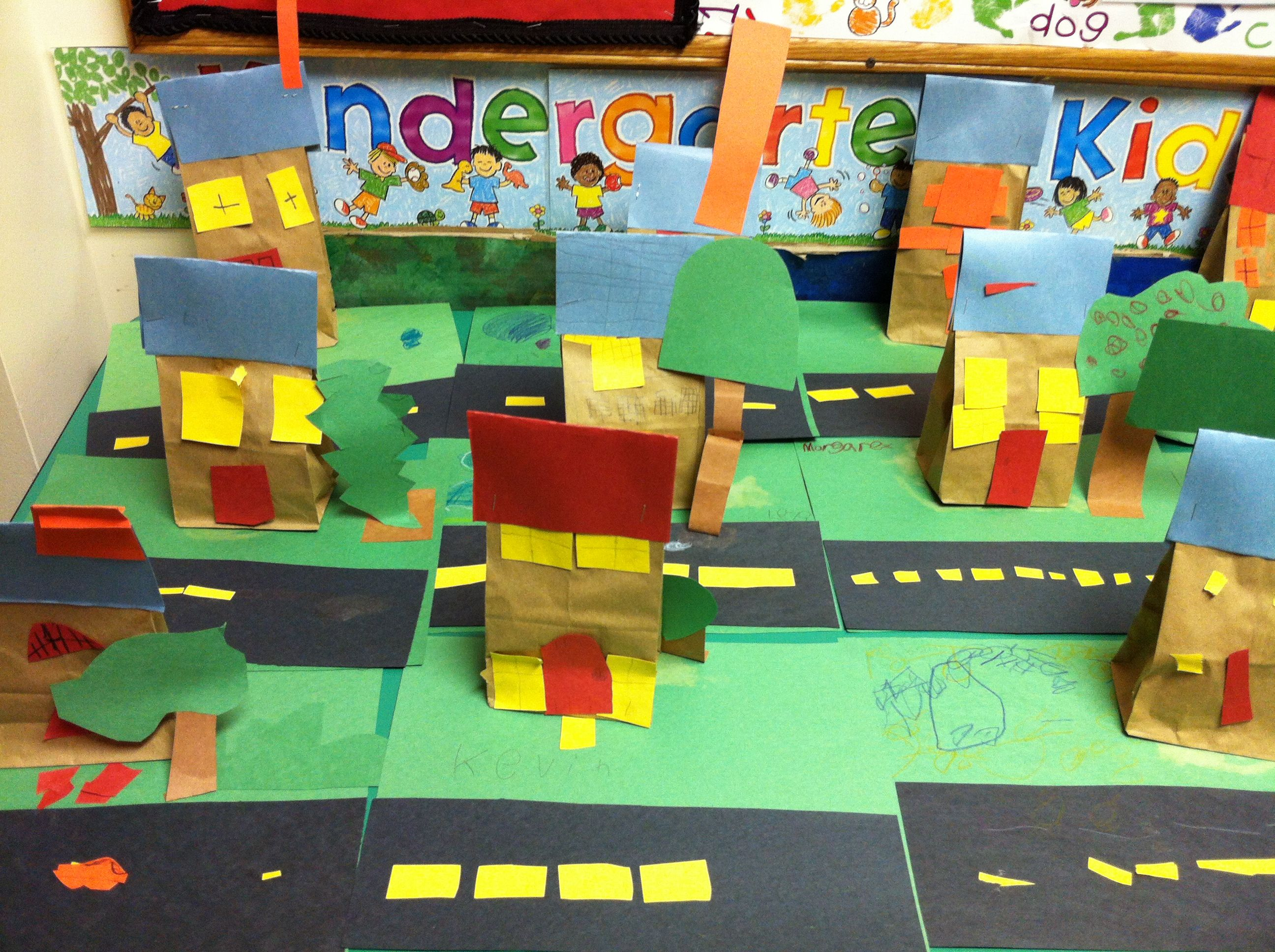 """Paper bag house neighborhood. After teaching the """"Me on the Map"""" unit and about neighborhoods, each student was given a paper bag and some construction paper to decorate and create their own house."""