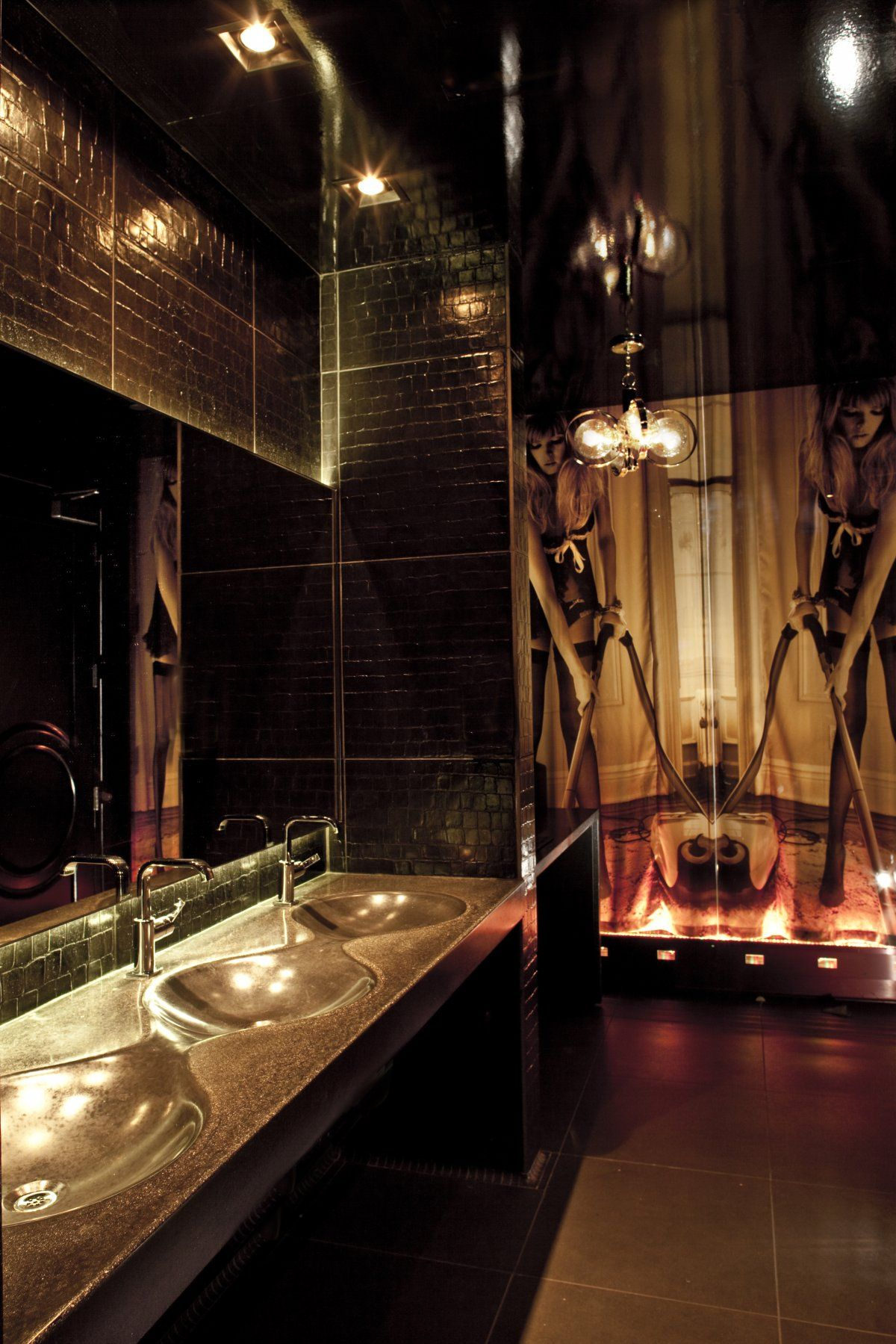 Hotel Room Wall: The Men's Room At Vanity Boasts Flat Screens Over The