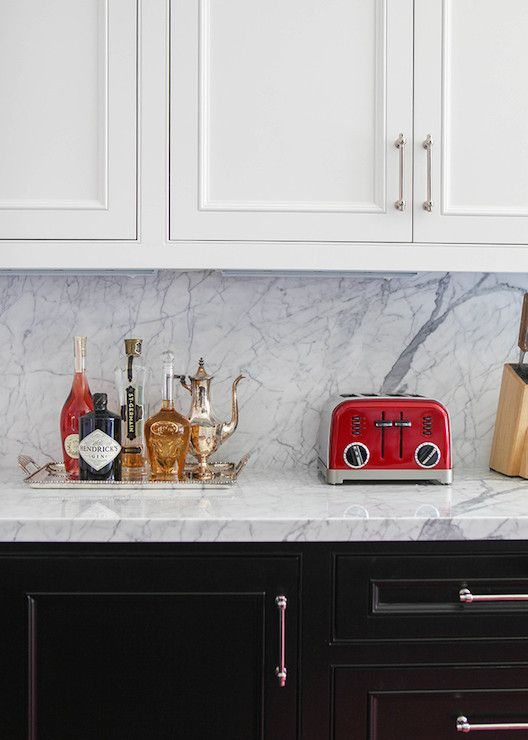 Bon Two Tone Kitchen Features White Upper Cabinets And Black Base Cabinets  Paired With White Marble Countertops And Matching Slab Backsplash