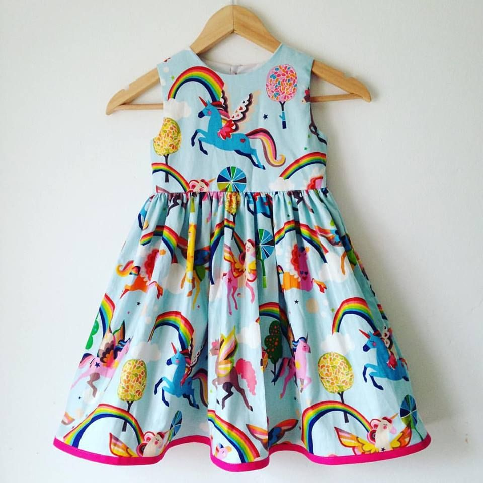 cb8ed7b4afb56 Brand new unicorn fabric! Magical unicorns and rainbows dress. 100% cotton  fabric with colourful rainbows and unicorns all over against a pale blue ...
