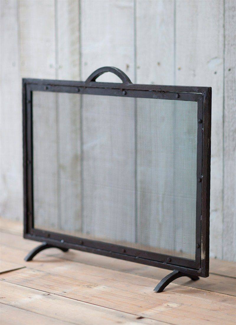 heavy wrought iron frame and mesh cover this fireguard has been