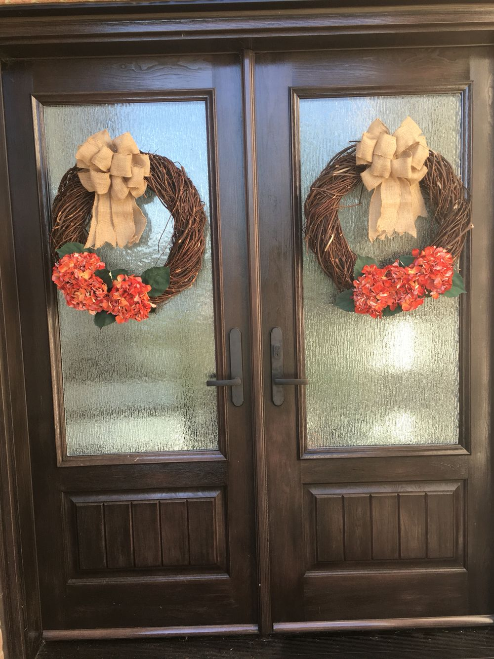 Fall DIY wreath with silk hydrangeas and burlap bow. Used floral wire, not hot glue, to hold it all together. All hobby lobby items.