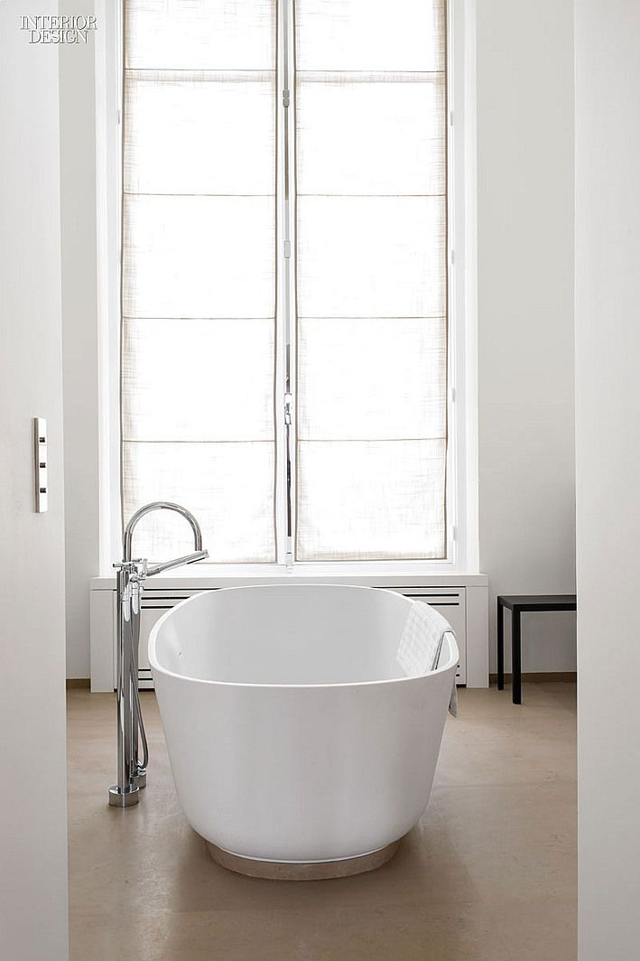 Self-Portrait with Furniture: Pierre Yovanovitch's Paris Apartment | Carlo Colombo designed the tub in the limestone-floored master bathroom. #design #interiordesign #interiordesignmagazine #architecture #bathroom #bathtub #decor