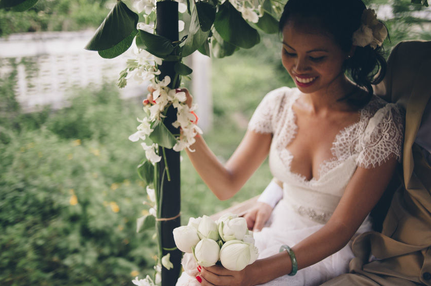 Nataly on her way to her wedding in Kep, Cambodia, with her beautiful lotus flower bouquet