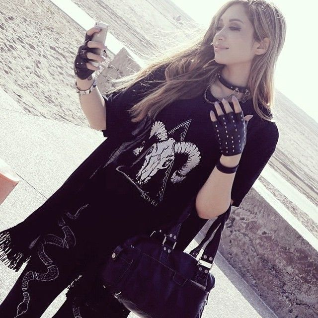 Another lovely (and badass) photo of @djheavygrinder in the ram skull destroyed muscle tank, broken serpent leggings, and witching hour fringe cloak ❤️ #sovrin #ootd #occult #occultfashion #djheavygrinder #supporthandmade