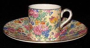 This is a Royal Winton Grimwades, England demitasse cup and saucer or coffee can and saucer in the pattern called Kinver chintz with gold trim dating to 1934-1950.