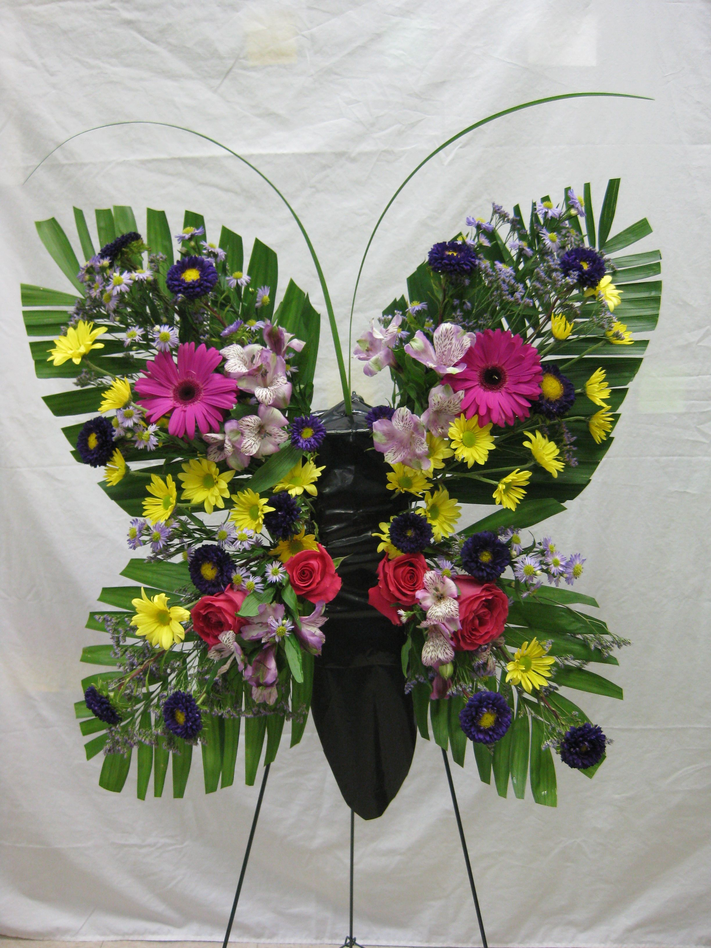 Funeral flower stand. funeralflowers butterfly