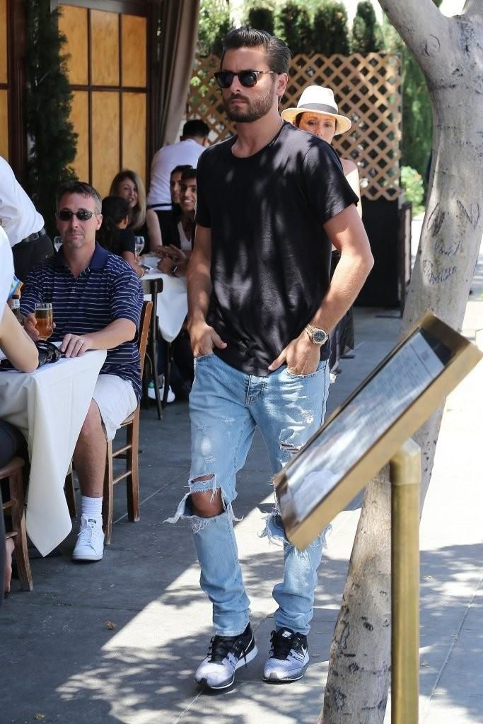 Scott Disick wearing Nike Flyknit Trainer+ Sneakers and Saint Laurent Small  Square Vintage Sunglasses