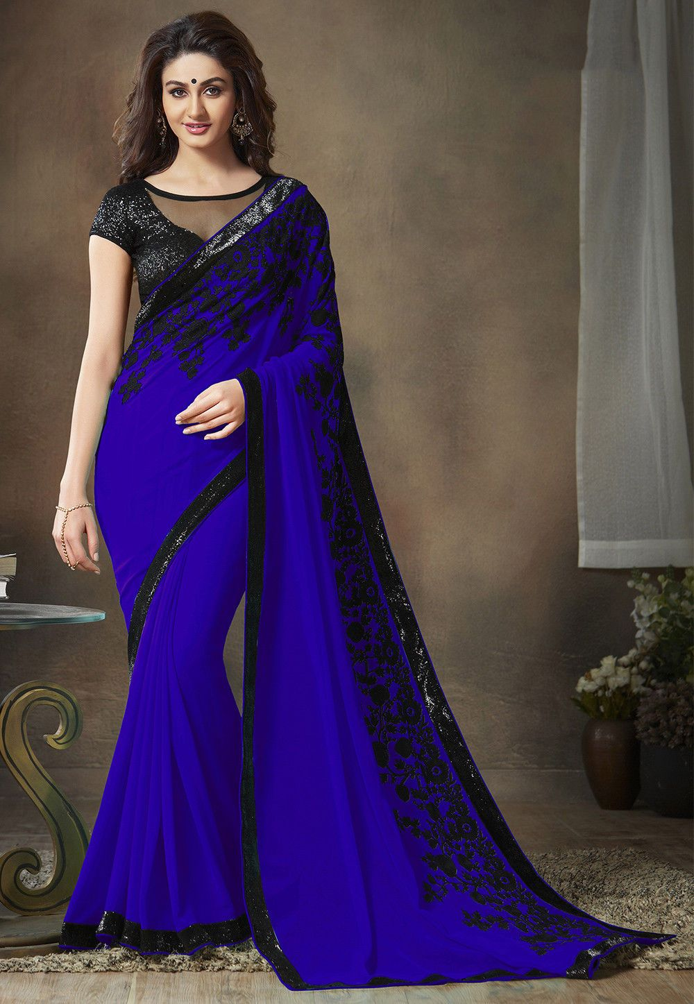 38601347aa6 Faux Georgette Saree in Royal Blue Enhanced with Woolen Thread ...