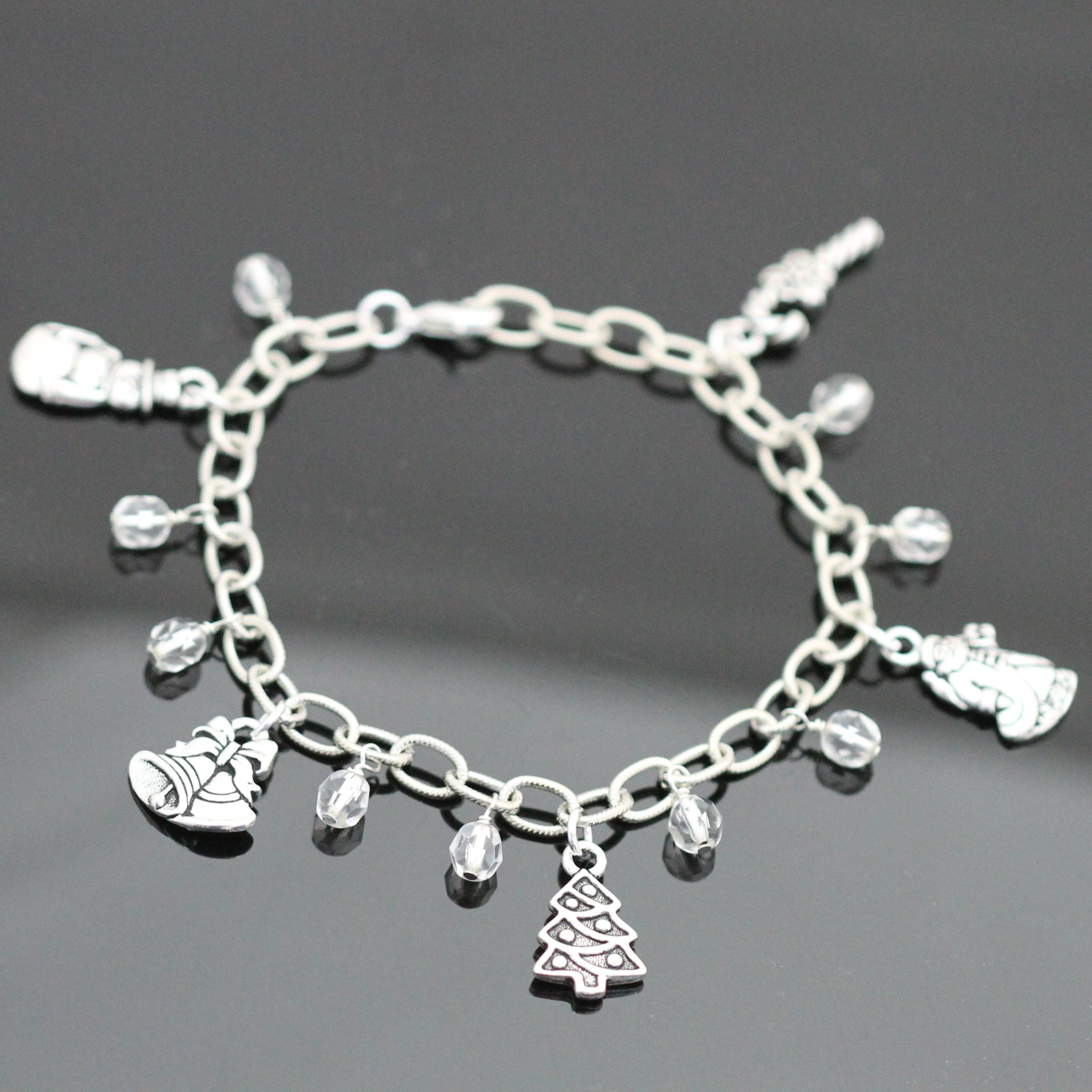 Learn to make our fun Christmas Sparkle Charm Bracelet with this FREE tutorial!  TierraCast charms and sparkling fire polish beads look great on this silver plated beauty.  Skills: wire wrapping and jump rings.  From Bead World Inc