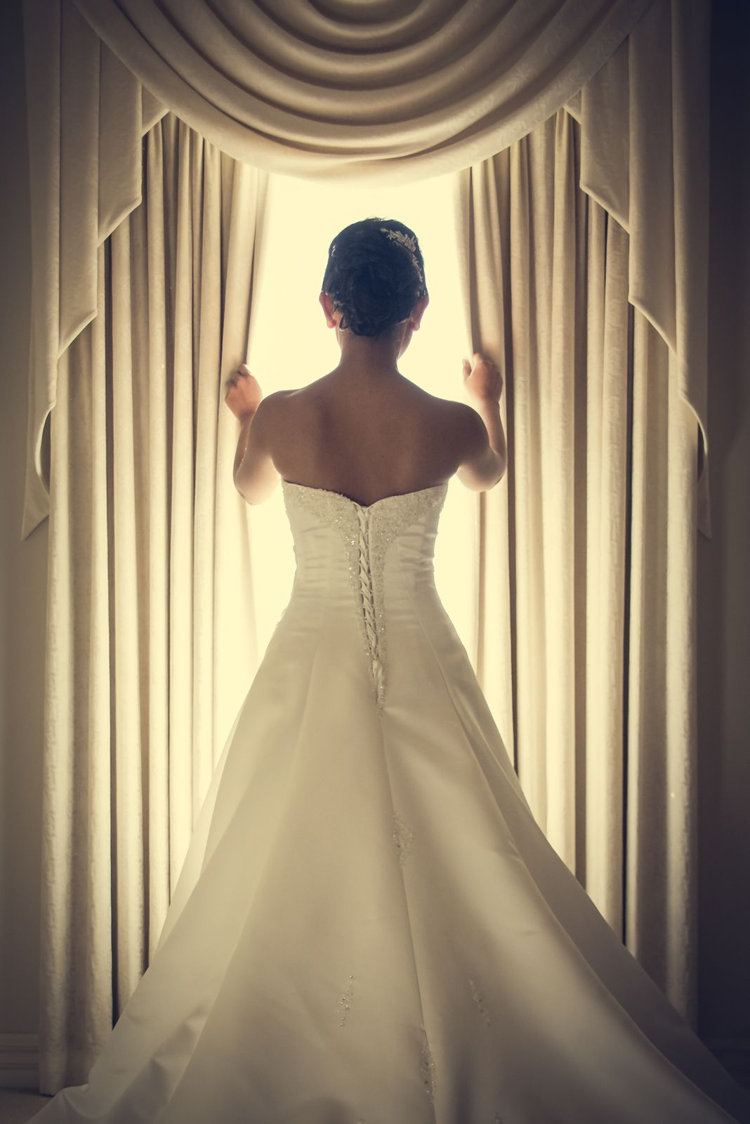 Beautiful back light bride in her stunning dress by Melbourne based photographer Anthony Ciardullo.    artimagephoto.com.au