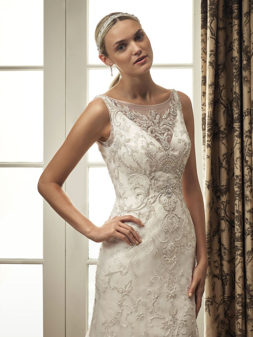 Fit and flare lace wedding dress  Beaded and embroidered tulle overlay with tank straps and scoop