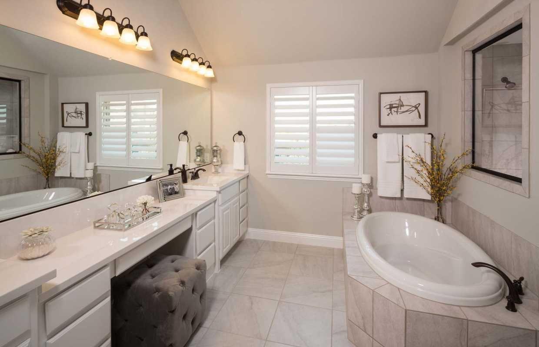 Dual Vanities And A Deep Garden Tub Provide Plenty Of Room For - Bathroom vanities fort worth tx