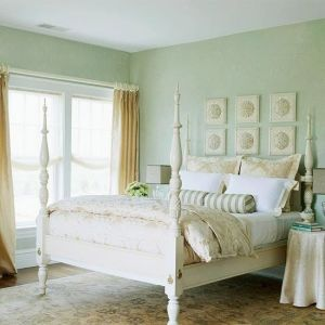 Beachy Keen: This bedroom is as pretty as a seaside scene. Sand-color drapes and bedding and pale seafoam-green walls evoke the misty moods by corine