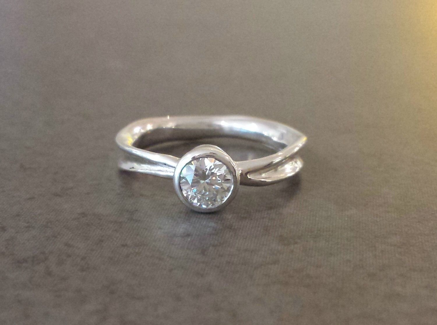 Moissanite engagement ring in recycled silver rustic engagement