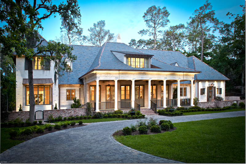 Southern acadian stucco and wood house houston tx for Southern custom homes