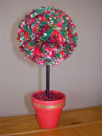 Fabric tree - Christmas fabric squares pushed into polystyrene ball which is fixed into painted plant pot