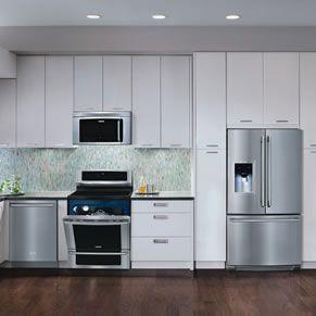 White cabinets, dark floors, ss appliances.