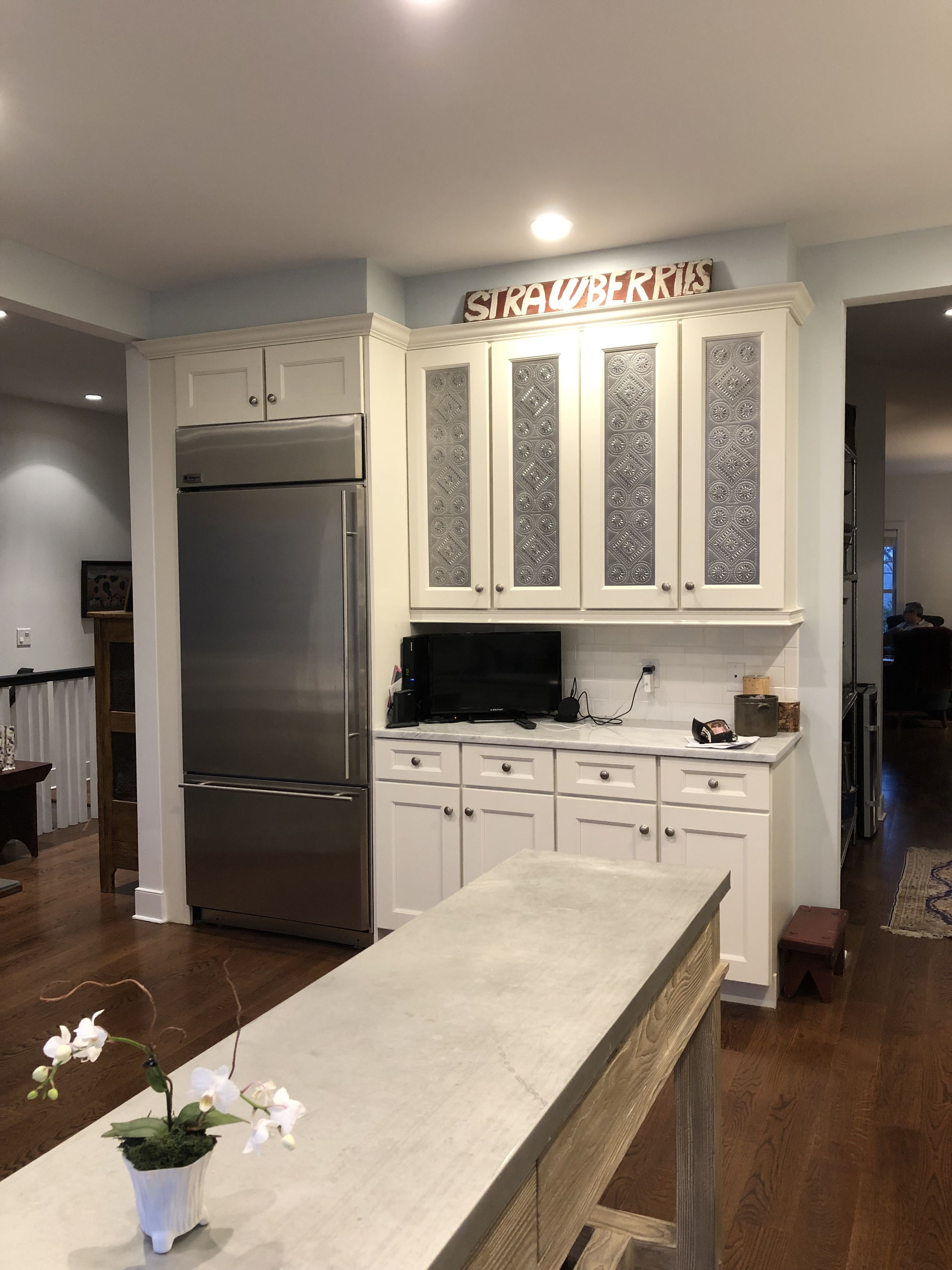 The Builder S Kitchen Cabinets After The Dyi Project Of Covering The Glass With Pierced Tin Panels Kitchen Cabinets Kitchen Tin Panel
