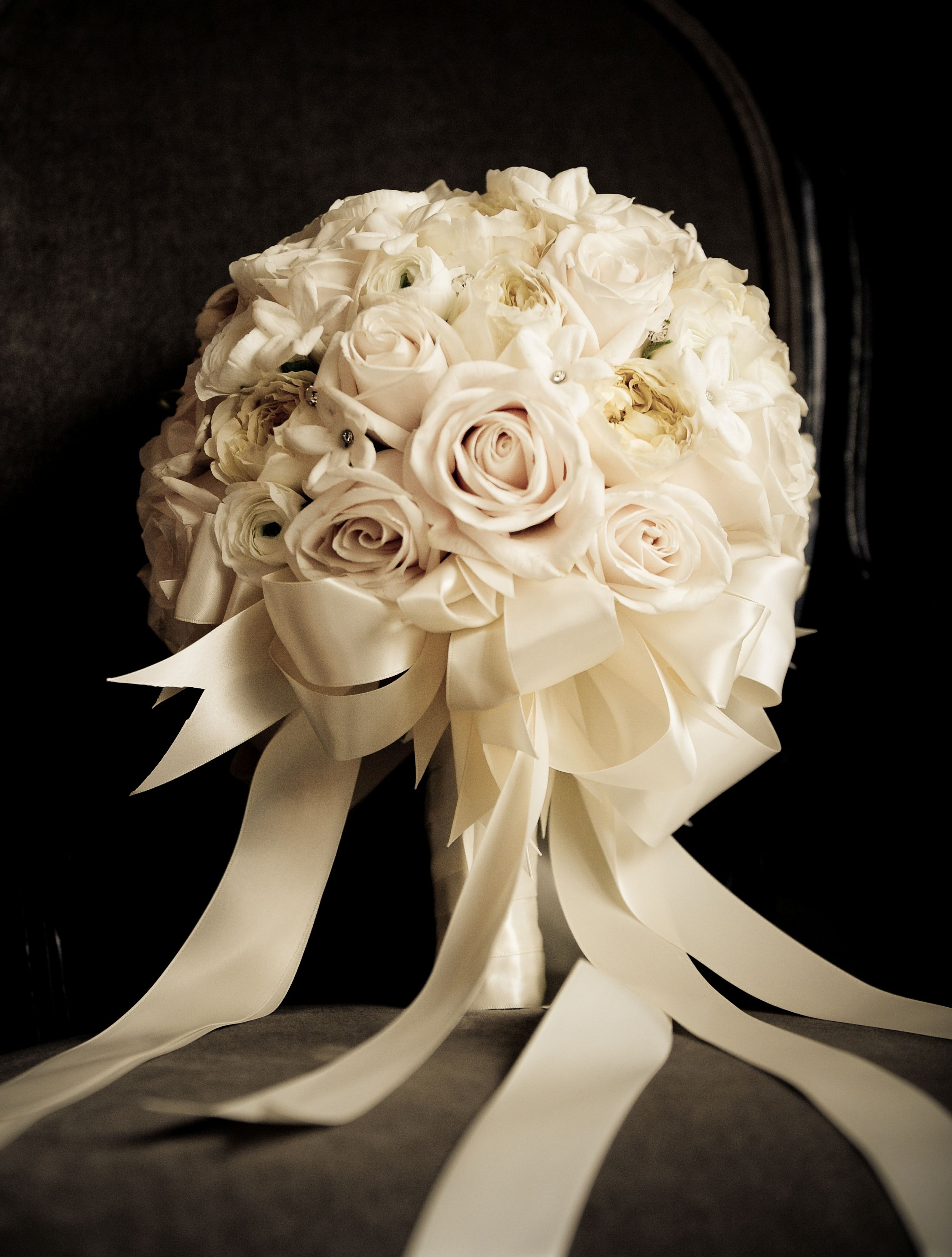 All white bride bouquet with white ribbon. Would go lovely with the ...