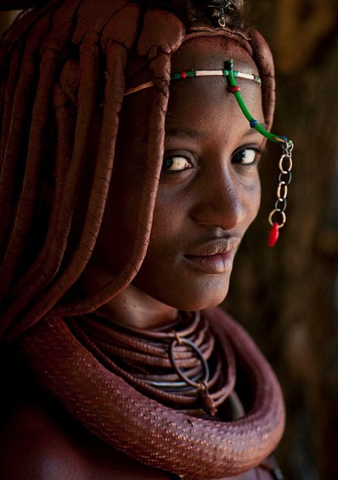 I love the little dangling thingie in front of the face - Lovely girl from Himba tribe, Angola