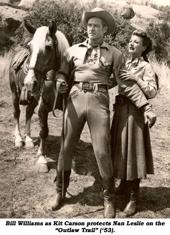 """Bill Williams as Kit Carson protects Nan Leslie on the """"Outlaw Trail"""" ('53)."""