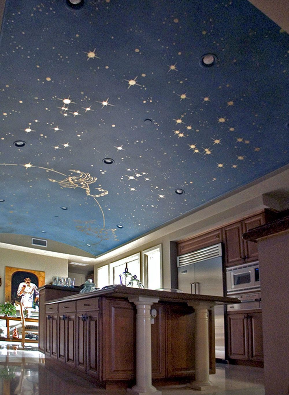 How relaxing to cook under the constellations! Gold leaf paint makes this ceiling  mural shine