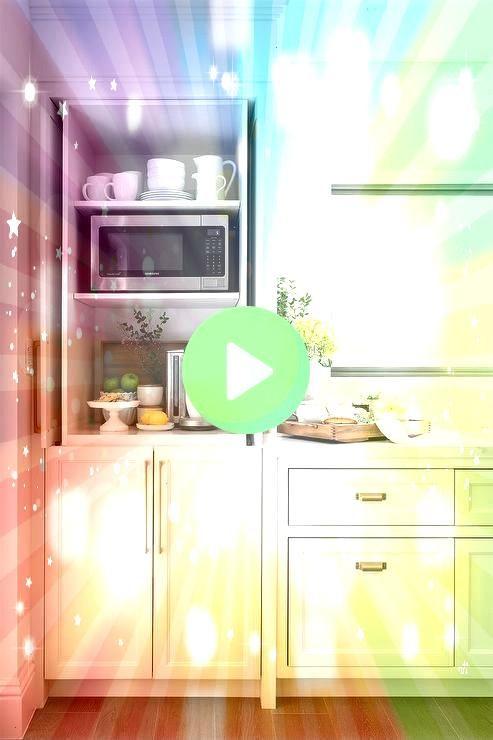 coffee station hidden by foldin white shaker cabinet pocket doors Kitchen coffee station hidden by foldin white shaker cabinet pocket doorsKitchen coffee station hidden b...