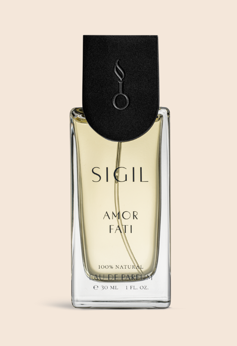 A philosophy beloved by ancient cultures across the globe, Sigil Scent Amor Fati represents the belief that all experiences from birth until death—all the moments of bliss, suffering, and striving—are essential to the cyclical beauty of our existence. Symbolizing both the ashes of death and the new growth of birth, Amor Fati combines smoky essences of oud and opoponax with the fresh and lively scents of bergamot and green pine needles. Resinous galbanum and palo santo ground the scent with hints