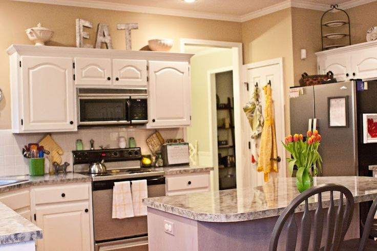 Decorating ideas for above kitchen cabinets and get inspired to ...