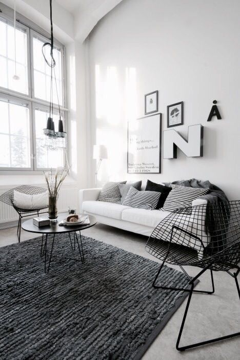 Speckled Black Carpet Defines This Space Living Room Furniture Sofas Scandi Style Living Room Rugs In Living Room