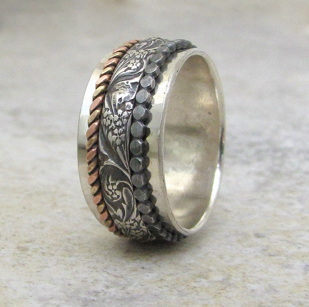 A Handmade Sterling Silver Ring with Inlaid Brass Dots.