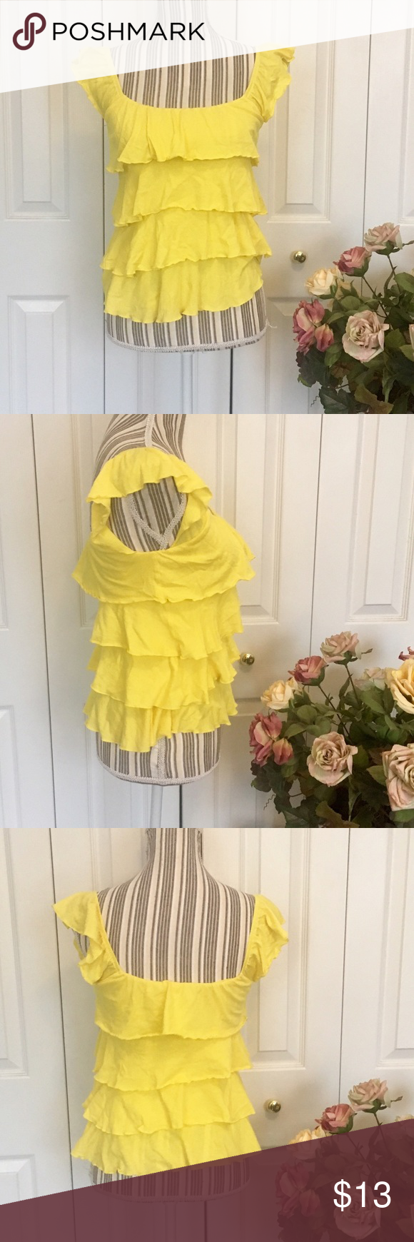 EXPRESS Modal Blend Bright Yellow Ruffle Blouse This Express bright yellow Ruffle tank is modal cotton blend for a pretty and flattering fit.  Size XS, measures 13 inches pit to pit and 23 inches shoulder to hem with lots of stretch.  No holes or pilling. Small discoloration on Ruffle in front as pictured. Express Tops