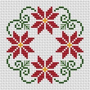 Photo of Beautiful styled Christmas wreath cross stitch patter with three colors: green, …