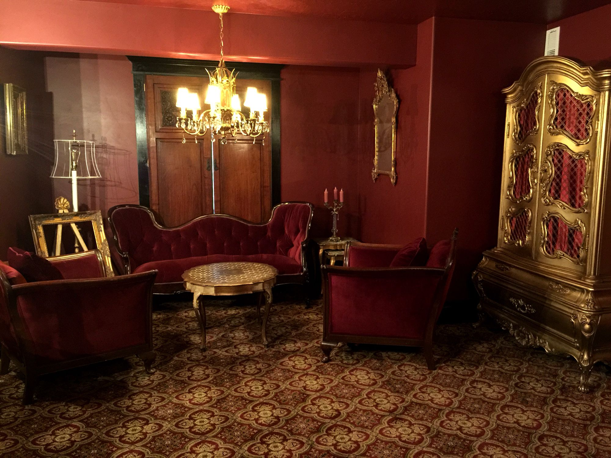 Parlor Room Maroon Velvet Sofa Paired With English Club