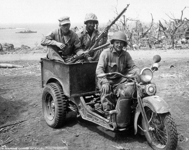 Japanese 3 wheel motorcycle repaired by U.S. Marines for own use. Photographed as action continued on Iwo Jima, Japan on April 16, 1945.