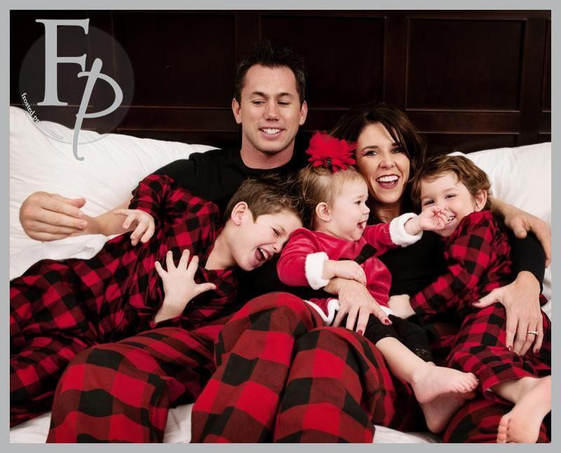 Family Photo In Christmas Pajamas Christmas Family Photos Fun Family Christmas Photos Family Holiday Photos