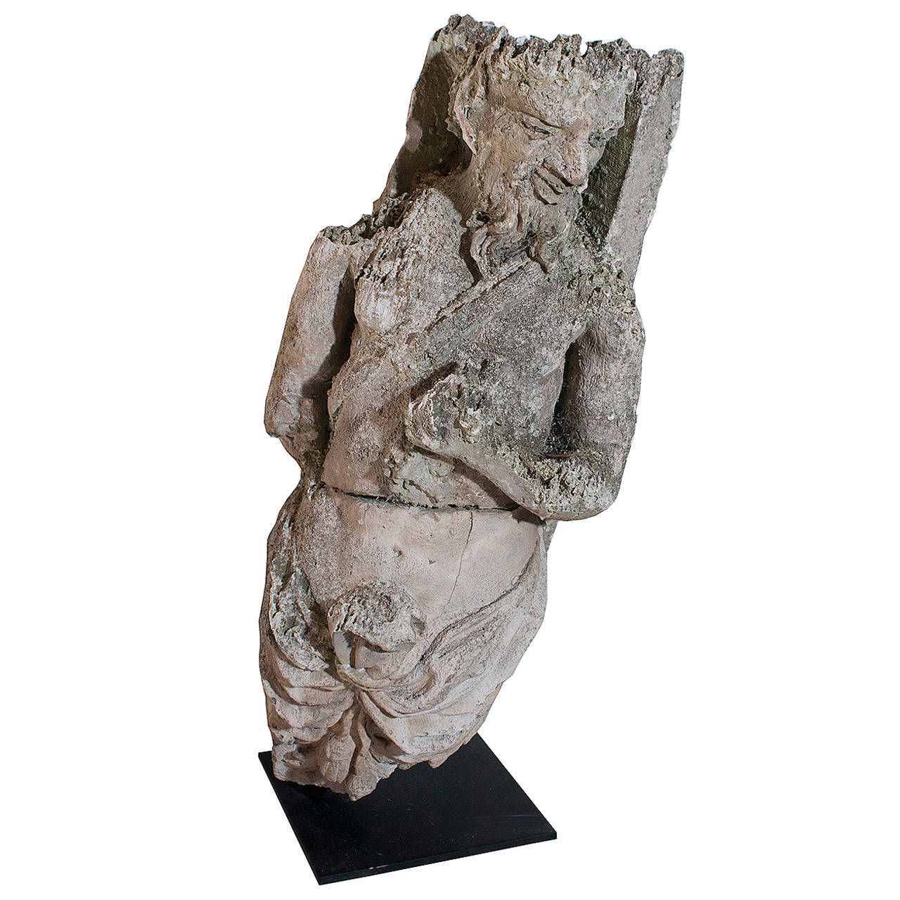 Limestone Sculpture of a Faun | From a unique collection of antique and modern statues at https://www.1stdibs.com/furniture/building-garden/statues/